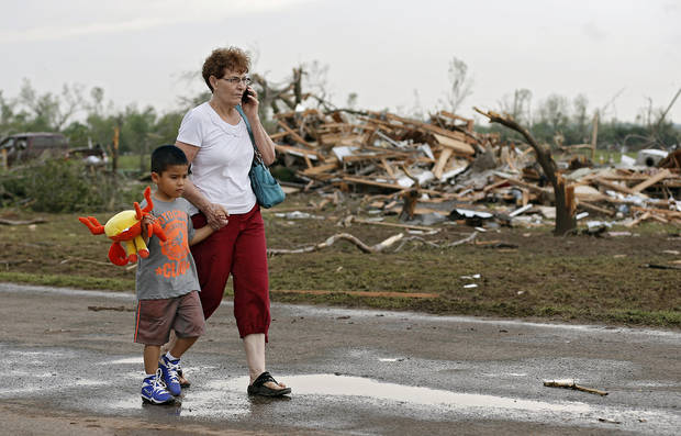 Chole Findley walks with her grandson Mark Williams as they leave the area where their home was destroyed  after the tornado hit the area near 149th and Drexel on Monday, May 20, 2013 in Oklahoma City, Okla.  Photo by Chris Landsberger, The Oklahoman
