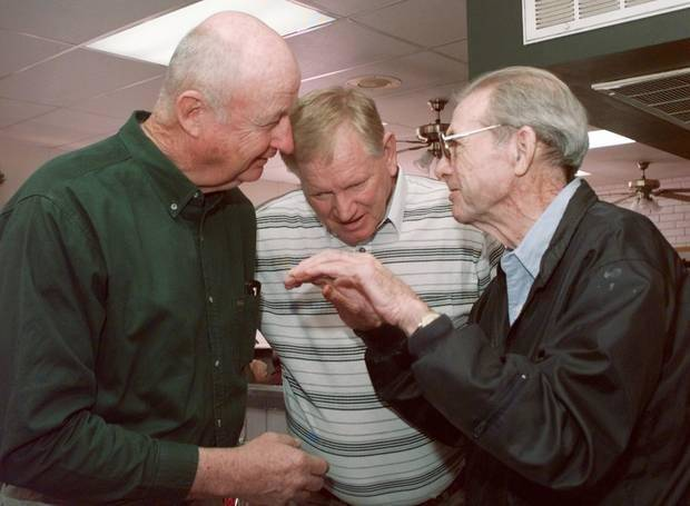 Hub Reed (left) and Leon Griffin (center), teammates on Oklahoma City University basketball teams in the 1950s, chat with their coach, Abe Lemons, in 1999. (Oklahoman archive photo)