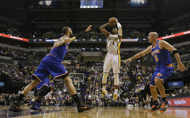 Indiana Pacers forward Paul George, center, shoots between New York Knicks defenders Tyson Chandler, left, and Jason Kidd during the second half of an NBA basketball game in Indianapolis, Wednesday, Feb. 20, 2013. The Pacers won 125-91. (AP Photo/AJ Mast)