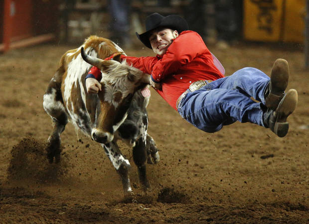 Donnie Tyner of Elm City, N.C. competes in steer wrestling during the International Finals Rodeo inside the State Fair Arena in Oklahoma City, Friday, Jan. 18, 2013. Photo by Bryan Terry, The Oklahoman