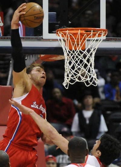 Los Angeles Clippers' Blake Griffin (32) goes up over Atlanta Hawks' Zaza Pachulia (27) in the first half of an NBA basketball game at Philips Arena in Atlanta, Saturday, Nov. 24, 2012. (AP Photo/David Tulis)