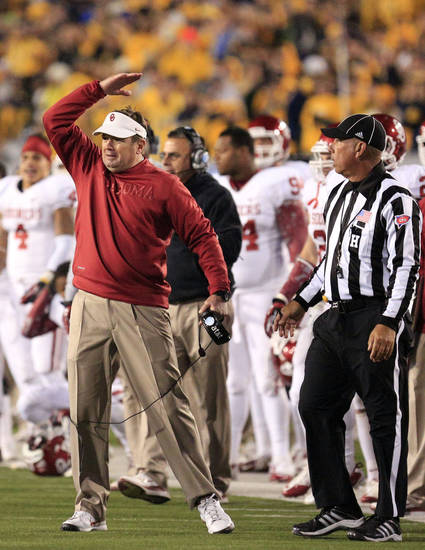 Oklahoma coach Bob Stoops reacts to a play during the second quarter of their NCAA college football game against Oklahoma in Morgantown, W.Va., on Saturday, Nov. 17, 2012. Oklahoma won 50-49. (AP Photo/Christopher Jackson)