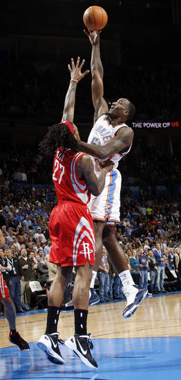 Oklahoma City's Kendrick Perkins (5) shoots over Jordan Hill (27) of Houston in the first quarter during the NBA basketball game between the Oklahoma City Thunder and the Houston Rockets at Chesapeake Energy Arena in Oklahoma City, Friday, Jan. 6, 2012. Photo by Nate Billings, The Oklahoman