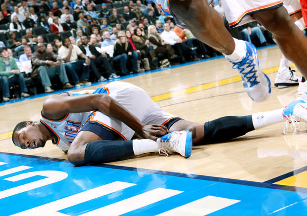 Oklahoma City&#039;s Kevin Durant is slow to get up after a collison in the first half of their game against Houston during their NBA basketball game at the OKC Arena in downtown Oklahoma City on Wednesday, Nov. 17, 2010. Photo by John Clanton, The Oklahoman