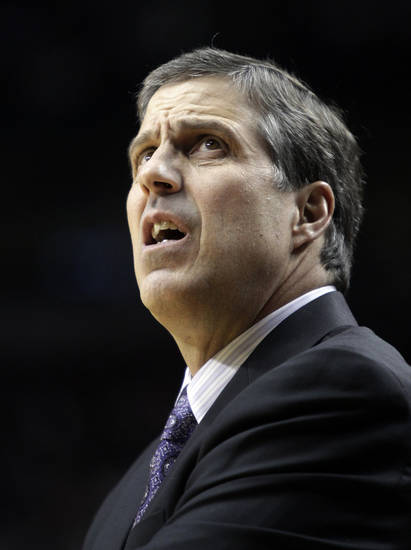 Washington Wizards coach Randy Wittman looks to the scoreboard during the first quarter of an NBA basketball game against the Portland Trail Blazers in Portland, Ore., Monday, Jan. 21, 2013.(AP Photo/Don Ryan)