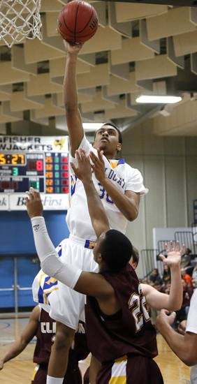 Piedmont's Adrion Williams (30) shoots the ball over Clinton's Jevin Jefferson (22) during a basketball tournament at the Kingfisher High School gym on Thursday, Jan. 24, 2013, in Kingfisher, Okla.  Photo by Chris Landsberger, The Oklahoman