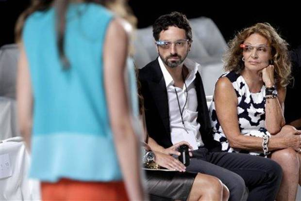 Diane Von Furstenberg watches a practice run of her Spring 2013 show with Google co-founder Sergey Brin during Fashion Week in New York, Sunday, Sept. 9, 2012. (AP Photo/Seth Wenig)
