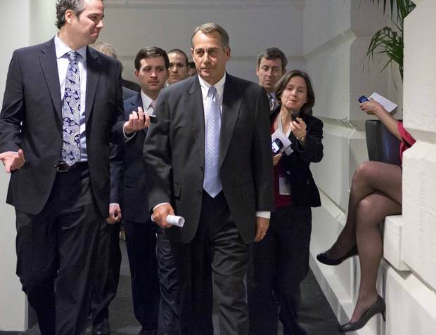 "Reporters pursue Speaker of the House John Boehner, R-Ohio, as he walks to a closed-door meeting with GOP members of the House as Congress in Washington, Monday, Dec. 31, 2012, as Senate and House leaders rush to assemble a last-ditch agreement to head off the automatic tax hikes and spending cuts set to take effect Jan. 1, 2013. The House will miss the midnight Monday deadline lawmakers set for voting to avoid the ""fiscal cliff.""  (AP Photo/J. Scott Applewhite)"