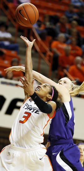 Oklahoma State's Tiffany Bias (3) shoots in front of Kansas State's Heidi Brown (10) during an NCAA women's basketball game between Oklahoma State University (OSU) and Kansas State at Gallagher-Iba Arena in Stillwater, Okla., Saturday, Feb. 16, 2013. Photo by Nate Billings, The Oklahoman