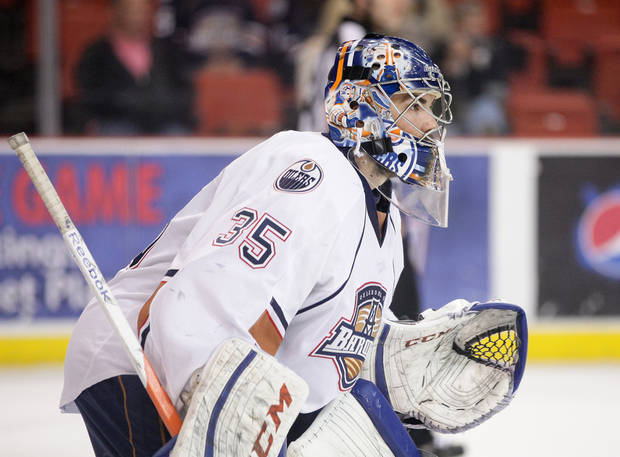 Oklahoma City Barons goaltender Yann Danis guards the net during Thursday night's AHL hockey playoff game against the Texas Stars at the Cox Convention Center. Photo by Steven Christy, For The Oklahoman