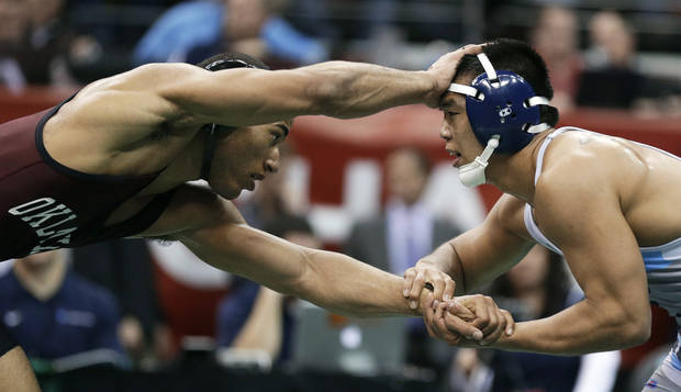 Oklahoma's Kendric Maple, left, controls Citadel's Ugi Khishignyam during their 141-pound semifinal at the NCAA Division I wrestling championships, Friday, March 22, 2013, in Des Moines, Iowa. (AP Photo/Charlie Neibergall)