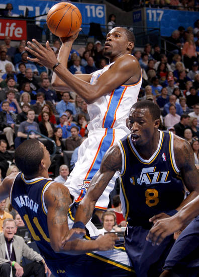 Oklahoma City's Kevin Durant (35) goes to the basket between Utah's Earl Watson (11) and Josh Howard (8) during an NBA game between the Oklahoma City Thunder and the Utah Jazz at Chesapeake Energy Arena in Oklahoma CIty, Tuesday, Feb. 14, 2012. Photo by Bryan Terry, The Oklahoman