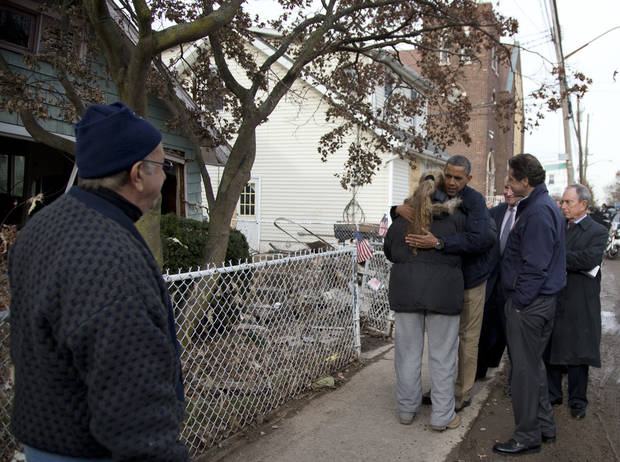 <p>President Barack Obama, accompanied by New York City Mayor Michael Bloomberg, New York Gov. Andrew Cuomo and Sen. Charles Schumer, D-N.Y., hugs Debbie Ingenito on Cedar Grove Avenue, a street significantly impacted by Superstorm Sandy, Thursday, Nov. 15, 2012, on Staten Island, in New York. (AP Photo/Carolyn Kaster)</p>