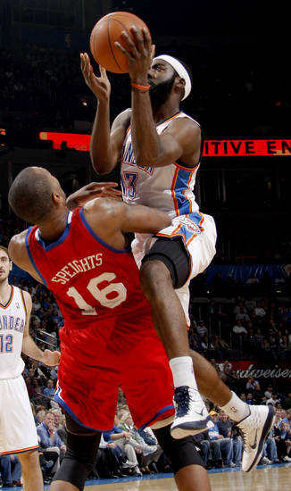 Oklahoma City's James Harden is called for a foul as he runs into Philadelphia's Marreese Speights during the NBA basketball game between the Oklahoma City Thunder and the Philadelphia 76ers at the Oklahoma City Arena on Wednesday, Nov. 10, 2010.   Photo by Bryan Terry, The Oklahoman
