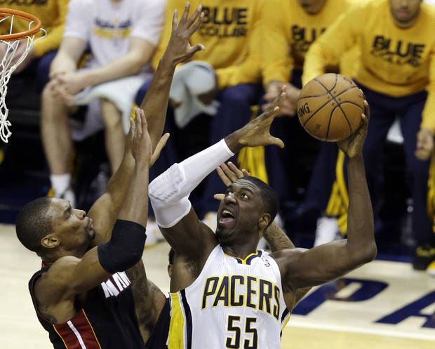 Indiana Pacers' Roy Hibbert (55) shoots against Miami Heat's Chris Bosh during the first half of Game 3 of the NBA Eastern Conference basketball finals in Indianapolis, Sunday, May 26, 2013. (AP Photo/Michael Conroy)