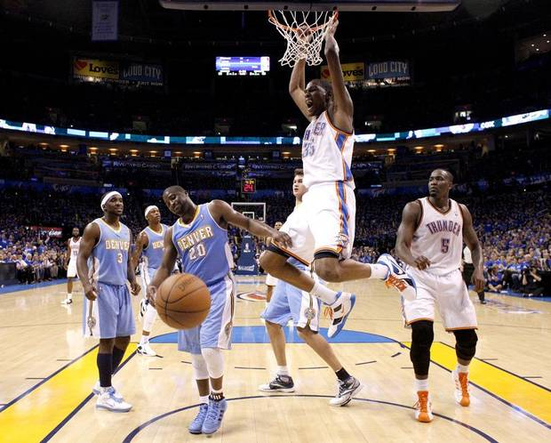 Oklahoma City's Kevin Durant (35) reacts after dunking the ball in front of Denver's Raymond Felton (20) during the first round NBA basketball playoff game between the Oklahoma City Thunder and the Denver Nuggets on Saturday, April 20, 2011, at the Oklahoma City Arena. Photo by Sarah Phipps, The Oklahoman ORG XMIT: KOD