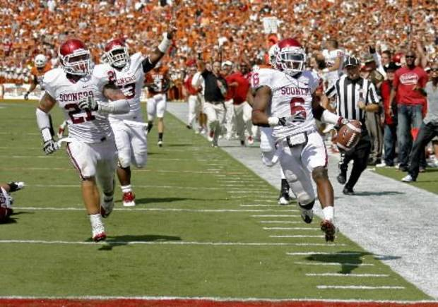 Oklahoma's Demontre Hurst (6) scores a touchdown beside Tom Wort (21), and Casey Walker (53) after an interception during the Red River Rivalry college football game between the University of Oklahoma Sooners (OU) and the University of Texas Longhorns (UT) at the Cotton Bowl in Dallas, Saturday, Oct. 8, 2011. Photo by Bryan Terry, The Oklahoman