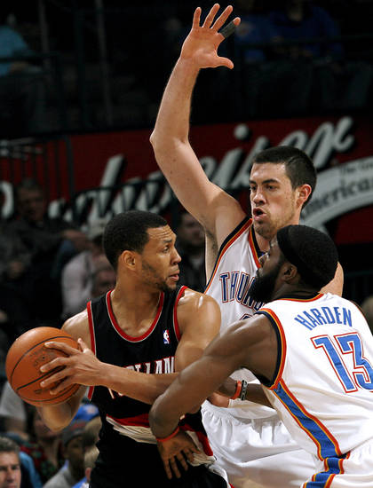 Oklahoma City's Nick Collison and James Harden combine to pressure  Portland's Brandon Roy during their NBA basketball game at the Ford Center in Oklahoma City, Okla., on Sunday, March 28, 2010. Photo by John Clanton, The Oklahoman