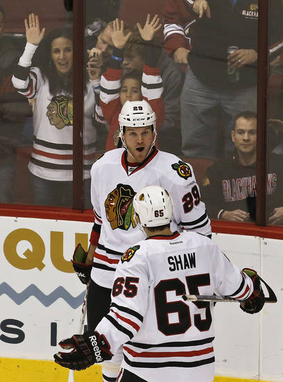 Chicago Blackhawks' Bryan Bickell (29) celebrates his goal against the Phoenix Coyotes with teammate Andrew Shaw (65) during the second period in an NHL hockey game Thursday, Feb. 7, 2013, in Glendale, Ariz.(AP Photo/Ross D. Franklin)