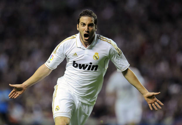 Real Madrid's Gonzalo Higuain from Argentina celebrates after scored against Athletic Bilbao, during their Spanish La Liga soccer match, at San Mames stadium in Bilbao, northern Spain, Wednesday, May 2, 2012. (AP Photo/Alvaro Barrientos)