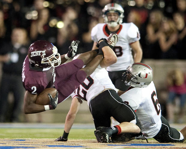 HIGH SCHOOL FOOTBALL: Jenks receiver Jordan Smallwood is twisted to the ground by Union safety Chase Dahlquist at H.A. Chapman Stadium, Sept. 9, 2011. JEFF LAUTENBERGER/Tulsa World ORG XMIT: DTI1109092236302845
