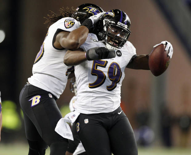 Baltimore Ravens inside linebacker Dannell Ellerbe (59) celebrates his interception of a pass by New England Patriots quarterback Tom Brady during the second half of the NFL football AFC Championship football game in Foxborough, Mass., Sunday, Jan. 20, 2013.  The Ravens won 28-13 to advance to Super Bowl XLVII. (AP Photo/Stephan Savoia)