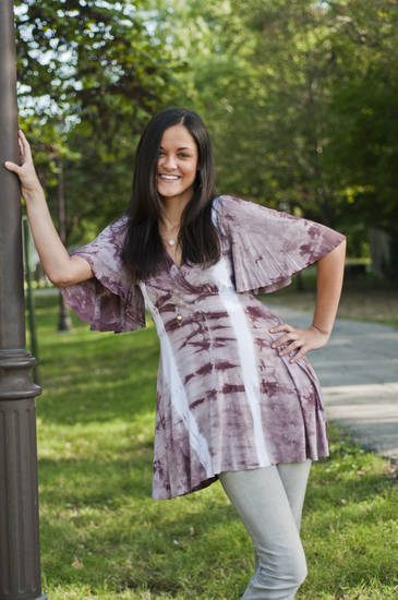 A tie-dye tunic paired with sparkling baubles is a playful paradox. Tie-dye tunic by T Party, $65. Ball necklace, $25, and drop necklace, $29, by Katybird. Silver sparkle hoops, $27. All from Shopgirls Boutique, 6245 Brookside Plaza, (816) 363-0229, shopgirls.com. Model Kaitlin, of Seven Model Management dons the look. (Courtesy Roy Inman via Kansas City Star/MCT)
