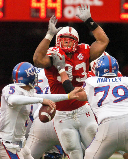 Nebraska's Ndamukong Suh, center, will try to break through the Oklahoma line today. AP PHOTO