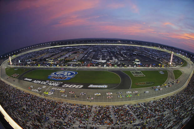 A colorful sky graces the Atlanta Motor Speedway during the NASCAR Sprint Cup Series auto race in Hampton, Ga., Sunday, Sept. 1, 2013. (AP Photo/John Bazemore)