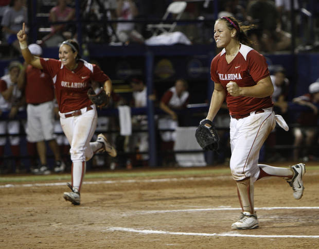 Oklahoma's Javen Henson (7) and Keilani Ricketts (10) celebrate during a Women's College World Series game between OU and Alabama at ASA Hall of Fame Stadium in Oklahoma City, Monday, June 4, 2012.  Photo by Garett Fisbeck, The Oklahoman