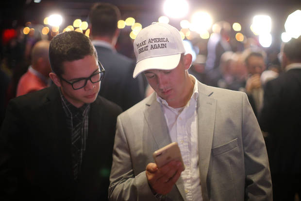 Preston Parks, left a University of Oklahoma student from Stratford, Okla., and Justin Vakulick an OU student from Blanchard, Okla., check election results during the Republican election night watch party for the 2018 elections at the Bricktown Events Center in Oklahoma City, Nov. 6, 2018. Photo by Bryan Terry, The Oklahoman