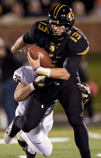 Missouri quarterback Corbin Berkstresser, top, is sacked by Vanderbilt linebacker Chase Garnham, bottom, during the fourth quarter of an NCAA college football game, Saturday, Oct. 6, 2012, in Columbia, Mo. Vanderbilt won the game 19-15. (AP Photo/L.G. Patterson)