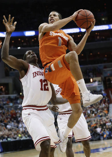 Syracuse guard Michael Carter-Williams (1) goes up past Indiana forward Hanner Mosquera-Perea (12) during the second half of an East Regional semifinal in the NCAA men's college basketball tournament, Thursday, March 28, 2013, in Washington. (AP Photo/Pablo Martinez Monsivais) ORG XMIT: VZN220