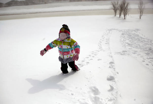 Natalyn Varney, 5, walks up a hill after sledding in a northwest Oklahoma City neighborhood, Tuesday, Feb. 1, 2011. Photo by Sarah Phipps, The Oklahoman