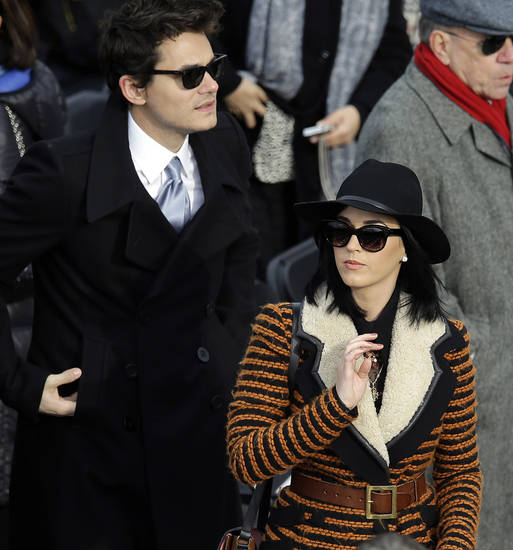 John Mayer and Katy Perry arrives for the ceremonial swearing-in of President Barack Obama at the U.S. Capitol during the 57th Presidential Inauguration in Washington, Monday, Jan. 21, 2013. (AP Photo/Carolyn Kaster)