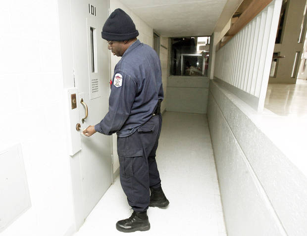 Sgt. Michael Hooks unlocks a cell at the Joseph Harp Correctional Center in  Lexington. Salaries for prison guards in Oklahoma can start at $24,605 for adult facilities and $21,521  for juvenile lockups. PHOTO BY  SARAH PHIPPS,  OKLAHOMAN ARCHIVE