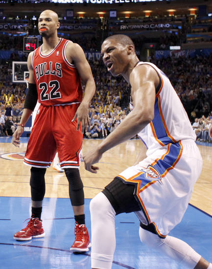 Oklahoma City's Russell Westbrook (0) celebrates a dunk in front of Chicago's Taj Gibson (22) during the NBA basketball game between the Chicago Bulls and the Oklahoma City Thunder at Chesapeake Energy Arena in Oklahoma City, Sunday, April 1, 2012. Photo by Sarah Phipps, The Oklahoman