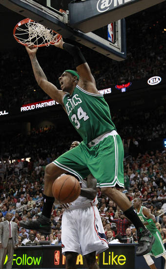 Boston Celtics forward Paul Pierce (34) scores in the second half of Game 2 of an NBA first-round playoff basketball series against the Atlanta Hawks on Tuesday, May 1, 2012, in Atlanta. Boston won 87-80 and evened the series at one game each. (AP Photo/John Bazemore)