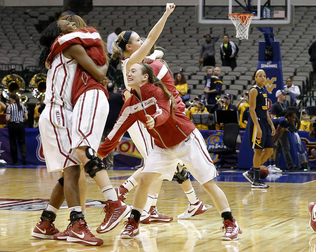 Oklahoma's Sharane Campbell, at kept, celebrates after the Big 12 tournament women's college basketball game between the University of Oklahoma and West Virginia at American Airlines Arena in Dallas, Saturday, March 9, 2012. Oklahoma won 65-64.  Photo by Bryan Terry, The Oklahoman