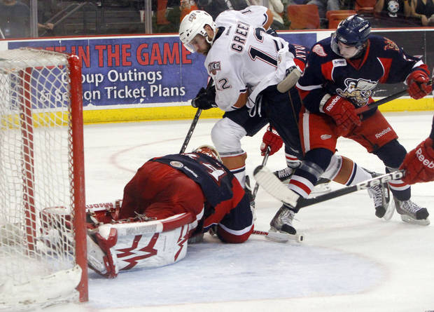 Oklahoma City Barons attacker Josh Green's shot is covered by Grand Rapids Griffins goaltender Petr Mzarek in the fourth game of the Western Conference finals of the AHL on June 1, 2013. Photo by KT KING, The Oklahoman ORG XMIT: OKC1306012126291030