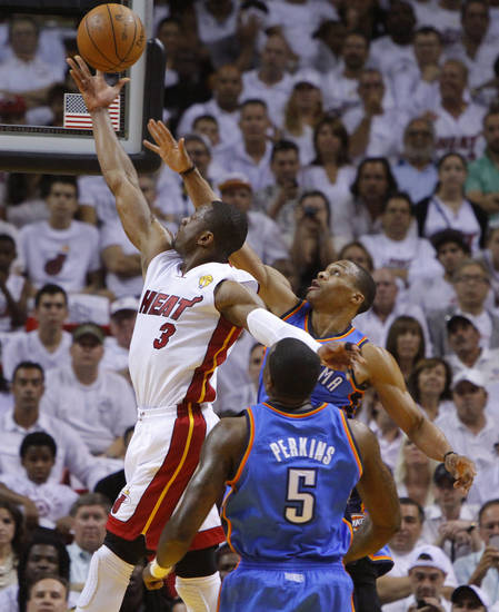 Miami's Dwyane Wade (3) goes past Oklahoma City's Russell Westbrook (0) and Kendrick Perkins (5) during Game 4 of the NBA Finals between the Oklahoma City Thunder and the Miami Heat at American Airlines Arena, Tuesday, June 19, 2012. Photo by Bryan Terry, The Oklahoman
