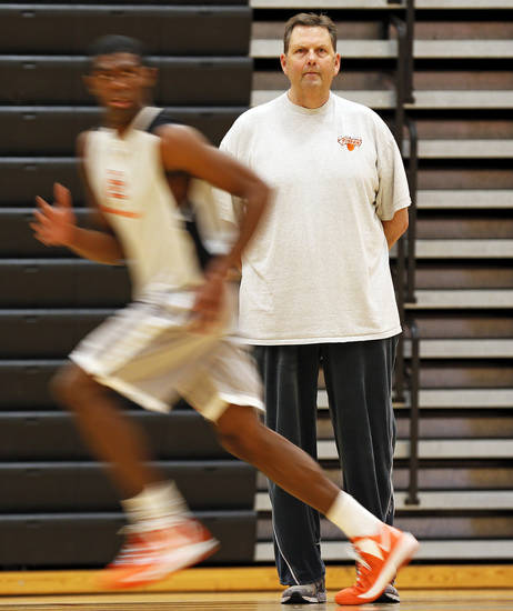 Putnam City head coach A.D. Burtschi watches a drill during the final basketball practice before the state tournament for the Putnam City Pirates boys basketball team at Putnam City High School in Warr Acres, Okla., Wednesday, March 6, 2013. Photo by Nate Billings, The Oklahoman