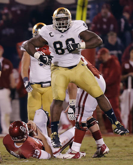 Notre Dame 's Kapron Lewis-Moore (89) celebrates a sack on OU's Landry Jones on the final play of the game during the college football game between the University of Oklahoma Sooners (OU) and the Notre Dame Fighting Irish at the Gaylord Family-Oklahoma Memorial Stadium on Saturday, Oct. 27, 2012, in Norman, Okla. Photo by Chris Landsberger, The Oklahoman