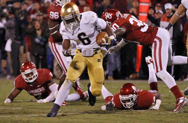 Notre Dame 's Theo Riddick (6) cuts through the Sooner defense to score a touchdown to put the Irish up 30-13 during the college football game between the University of Oklahoma Sooners (OU) and the Notre Dame Fighting Irish at the Gaylord Family-Oklahoma Memorial Stadium on Saturday, Oct. 27, 2012, in Norman, Okla. Photo by Chris Landsberger, The Oklahoman