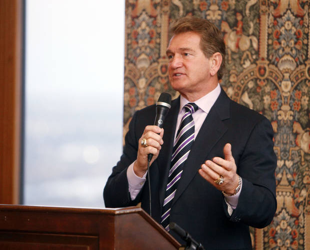 "Joe Theismann, former NFL star quarterback, speaks at the Bill Glass ""Breakfast of Champions"" Friday at the Petroleum Club in downtown Oklahoma City. <strong>PAUL HELLSTERN - Oklahoman</strong>"