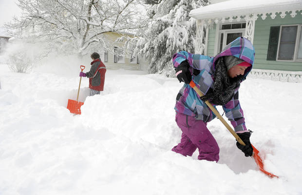 Paula Dugan, left, and her step-daughter Mariah Dugan, right, dig out after a heavy snowfall in Norwich, Conn., Saturday, Feb. 9, 2013.  A howling storm across the Northeast left much of the New York-to-Boston corridor covered with more than three feet of snow. Saturday, Feb. 9, 2013.  A howling storm across the Northeast left much of the New York-to-Boston corridor covered with more than three feet of snow.  (AP Photo/The Day, Sean D. Elliot)   MANDATORY CREDIT: THE DAY/SEAN D. ELLIOT ORG XMIT: CTNLD104