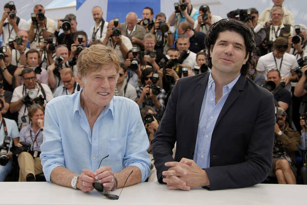 Actor Robert Redford, left, and director J.C. Chandor pose for photographers during a photo call for the film All is Lost at the 66th international film festival, in Cannes, southern France, Wednesday, May 22, 2013. (AP Photo/Francois Mori)