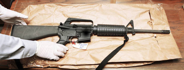 Oklahoma City say this AR-15 rifle was used in the 2010 assault on police officer Katie Lawson, who survived despite her assailant firing 20 rounds without reloading. The military-style rifle, shown in a 2011 photo, is similar to one used in the massacre in Connecticut this month. Photo by Jim Beckel, The Oklahoman <strong>JIM BECKEL - The Oklahoman</strong>
