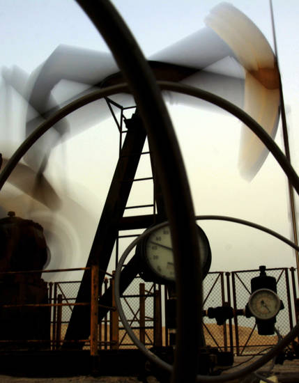 An oil pump works in the Persian Gulf desert oil fields of Sakhir, Bahrain. AP Photo
