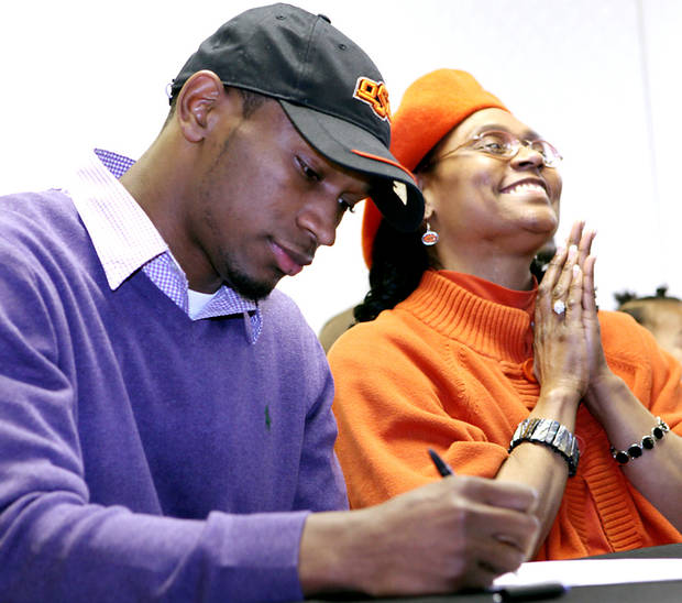 Joyce Randle reacts as her son, Joe Randle, signs a letter of intent to attend Oklahoma State University at a ceremony at Southeast High School in Wichita, Kan., on Wednesday, Feb. 3, 2010. Photo by John Clanton, The Oklahoman